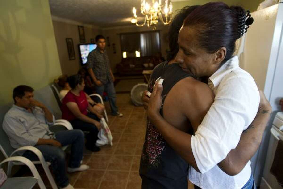 Janie Torres, right, hugs son Richard Molina Jr. as the family gathers Thursday to grieve the loss of her son, Army Sgt. Jacob Molina.