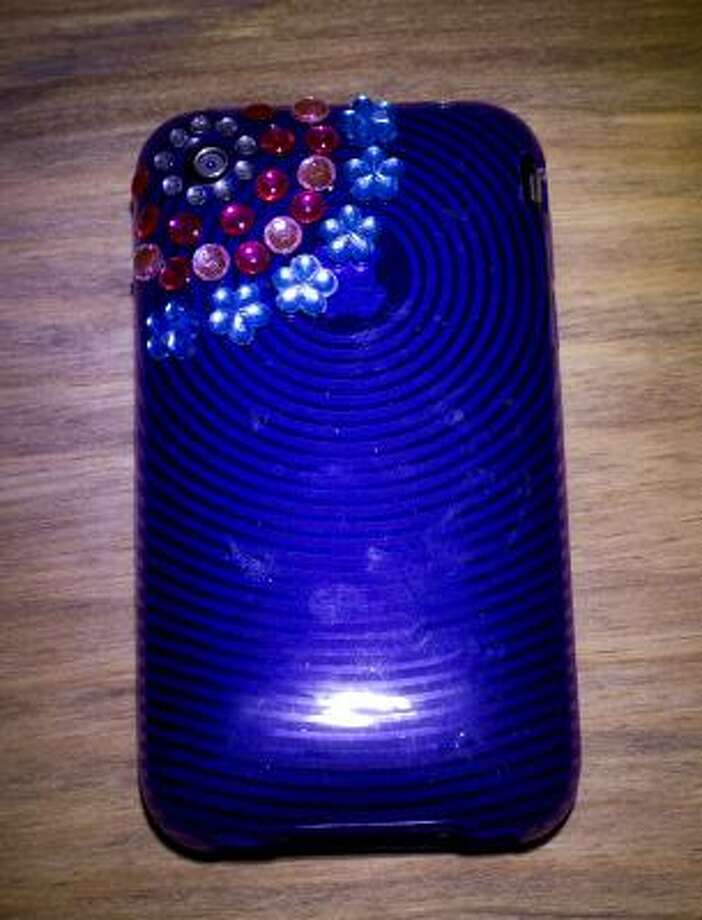 HOW TO FIND YOUR PHONE: Use a hot-glue gun to attach craft gemstones to your cellphone and give it a little bling. Bedazzlement can help your phone stand out. Photo: James Nielsen, Chronicle