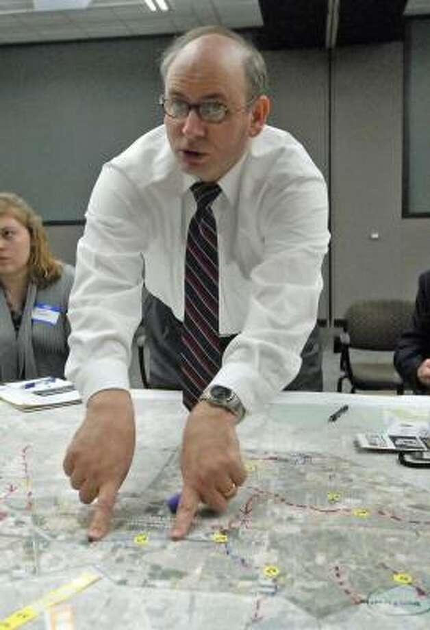 MAKING A POINT: Jersey Village City Manager Mike Castro discusses development along a section of a watershed map of Greens Bayou during a Greens Bayou Corridor Coalition public meeting. Photo: Tony Bullard, For The Chronicle