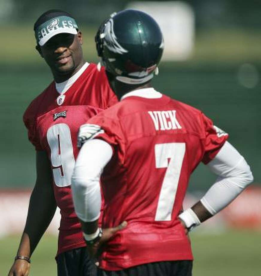 Philadelphia Eagles quarterbacks Vince Young (9) and Michael Vick (7) talk on the field during training camp at Lehigh University in Bethlehem, Pa. on Saturday. Photo: Rich Schultz, Associated Press