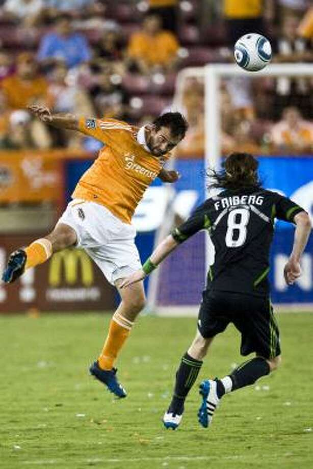 Dynamo midfielder Adam Moffat, left, has seen his playing time jump since being acquired from Portland. Photo: Patrick T. Fallon, Chronicle