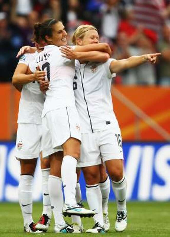 Team USA players celebrate their third goal during Saturday's win. Photo: Joern Pollex, Getty