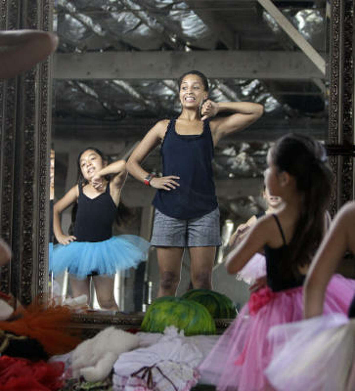 Megan Marcano teaches a class of young dancers at Houston's Red Door Productions last week. Megan was a homeless high school freshman when she found the dance troupe. Now she is a dance major at Texas Woman's University.