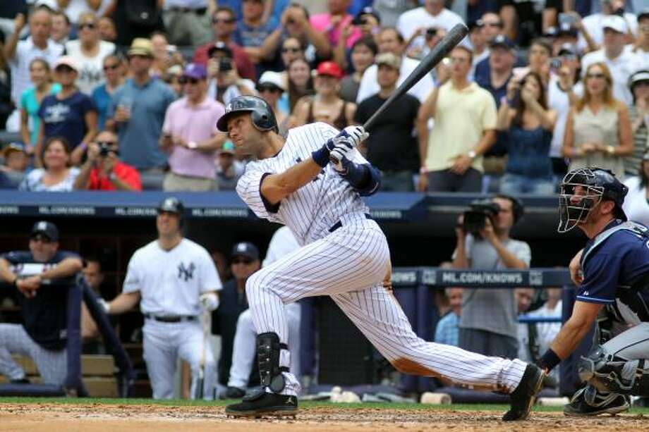 Derek Jeter hits a solo home run in the third inning for career hit 3000. Photo: Michael Heiman, Getty
