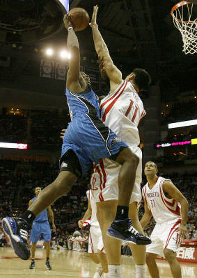 Yao Ming flourished in his matchups with Orlando's Dwight Howard, left. Yao averaged 23.6 points and 10.4 rebounds and limited the Magic star center to 12.2 points and 9.8 rebounds. The Rockets were 7-2 in the nine meetings between Yao and Howard. Photo: Nick De La Torre, Chronicle