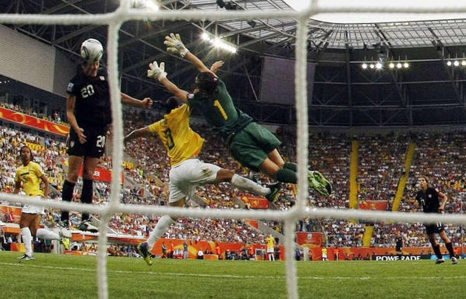 Abby Wambach's dramatic goal against Brazil helped the U.S. women reach today's World Cup semifinal. Photo: Marcio Jose Sanchez, Associated Press