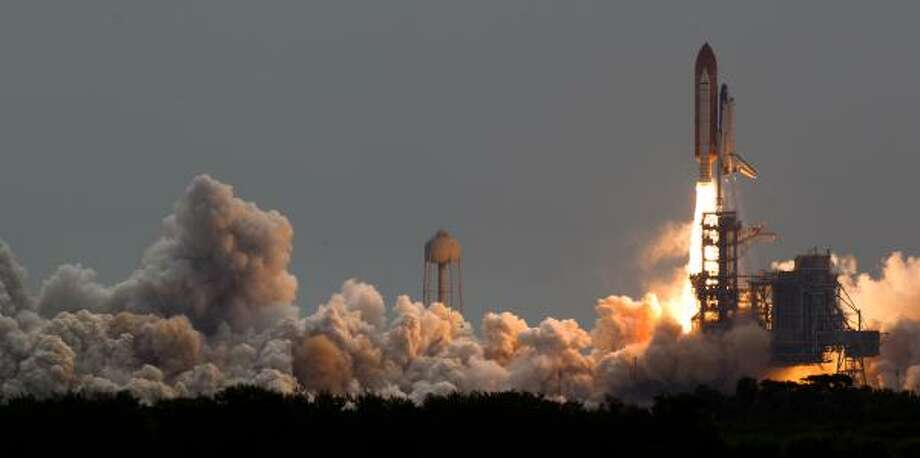 The space shuttle Atlantis launches for the STS-135 mission to the International Space Station in the final mission of the space shuttle program at the Kennedy Space Center in Florida. Photo: Smiley N. Pool, Houston Chronicle
