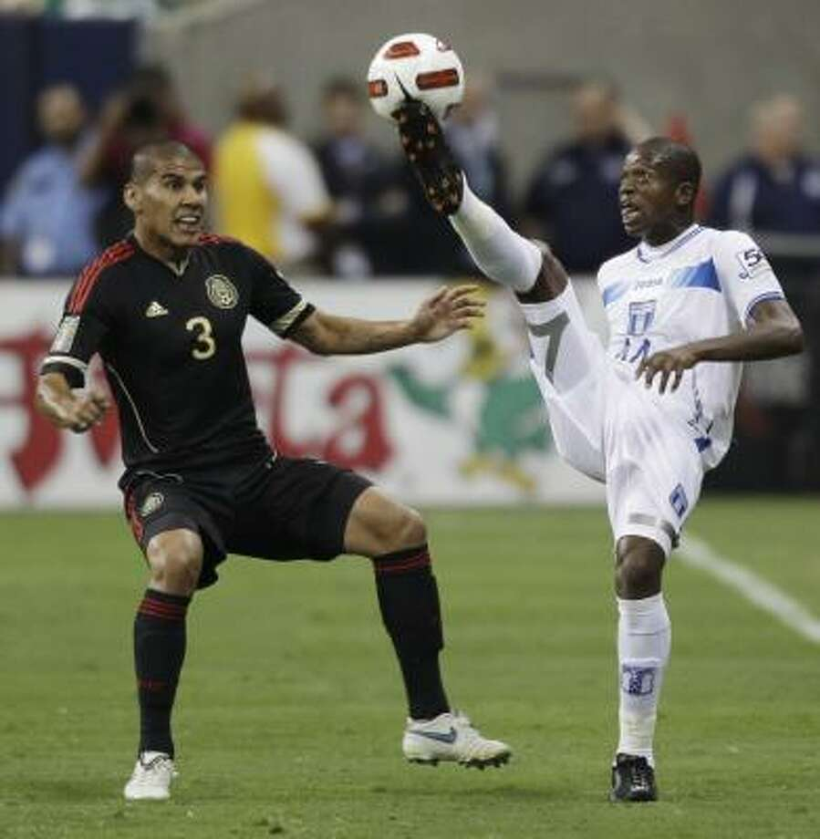 The Dynamo have given serious scrutiny to Honduran back Oscar Boniek Garcia (right), who in June played in Houston during a Gold Cup semifinal match against Mexico. Photo: David J. Phillip, Associated Press