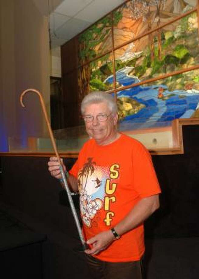 BLESSED WITH DONATION: John Morgan, founder of Sagemont Church, said the cane that belonged to the late Hiram Woosley has sentimental value. Woosley, who died in November 2010, was well-known and much-loved for visiting the ill at home or in area hospitals. Thanks to a bidder who wishes to remain anonymous, the cane is now worth more than $68,000 and still belongs to the church. Photo: George Wong, For The Chronicle