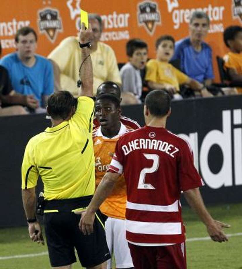 Dynamo defender Kofi Sarkodie earned a red card ejection for two yellows against Dallas in May. Photo: Johnny Hanson, Chronicle