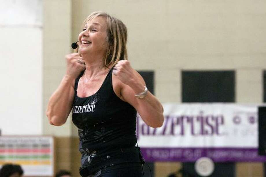 R. CLAYTON MCKEE: FOR THE CHRONICLE BOUNDLESS ENTHUSIASM: Jane Luco has been leading Jazzercise classes for more than 30 years.  She now teaches at Garden Oaks Baptist Church, 3206 North Shepherd Drive. Photo: R. Clayton McKee, For The Chronicle