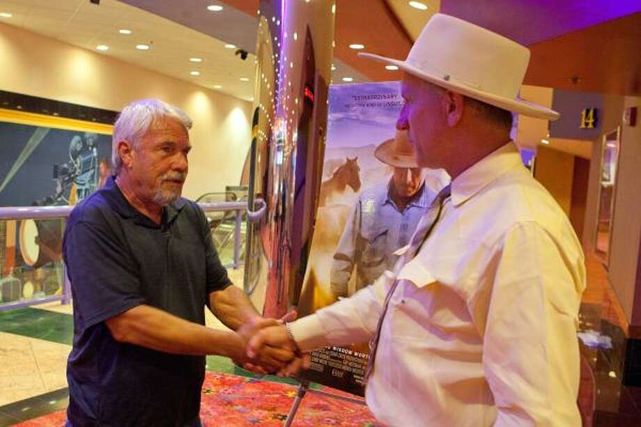 "LONG-AWAITED MEETING: Jerry Finch of Habitat for Horses talks with Buck Brannaman after a preview of the documentarty ""Buck,"" which chronicle's Brannaman's equestrian life. Photo: R. Clayton McKee, For The Chronicle"