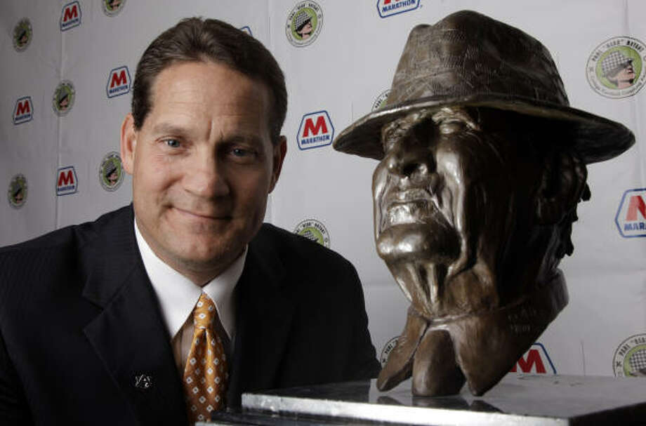 "Auburn coach Gene Chizik, winner of the Paul ""Bear"" Bryant College Coach of the Year Award, says he sees the hand of God working in his life, even in the outcome of college football games. Photo: DAVID J. PHILLIP, ASSOCIATED PRESS"