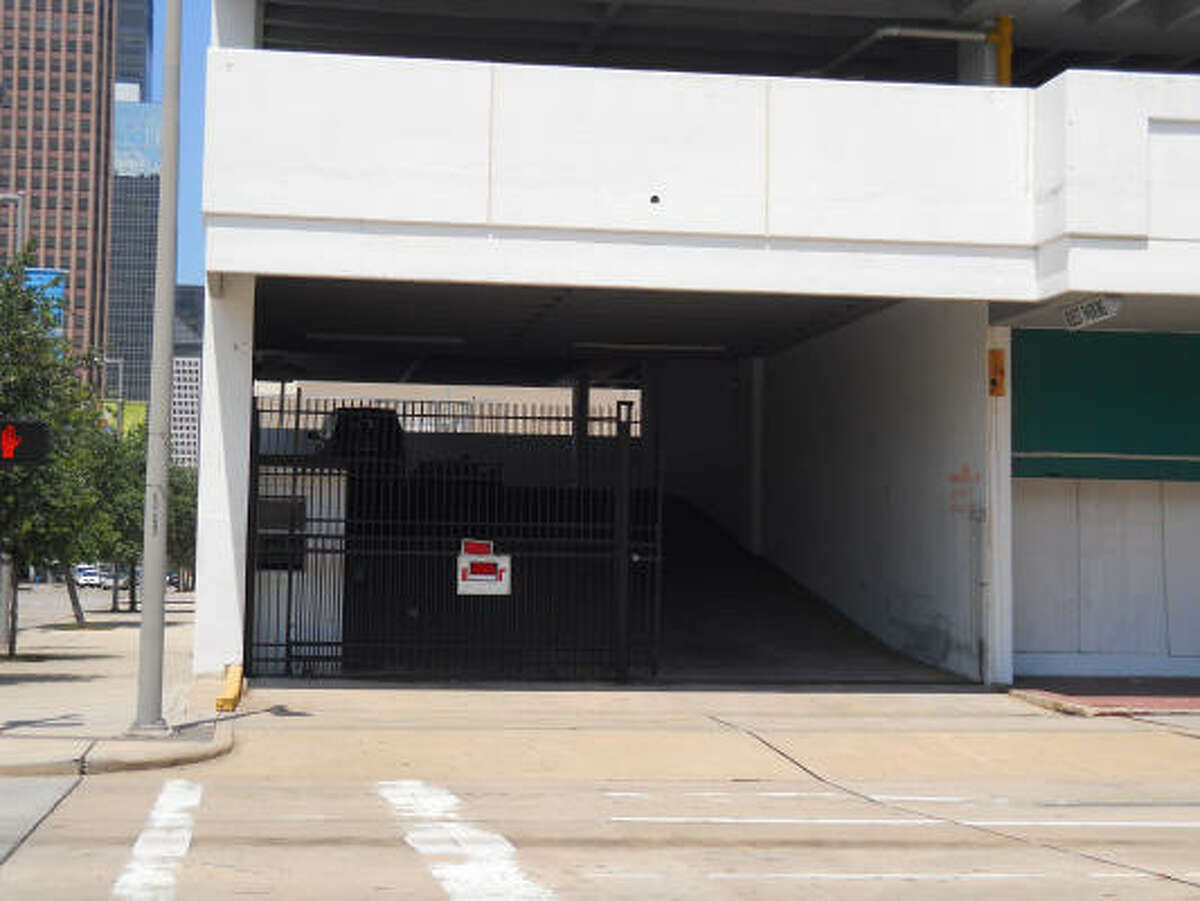 Developer New Era Hospitality has put a metal gate at the garage entrance to replace a chain-link fence.