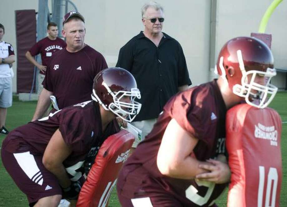 Mike Sherman (center) and the Aggies may be able to hold their own in the football-crazed SEC. Photo: Stuart Villanueva, Associated Press
