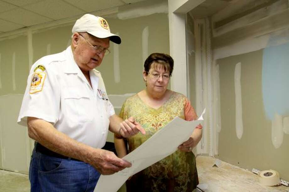 MUSEUM PLANS: Katy Veterans Memorial Museum at 6206 George Bush Drive is doubling its size of the display area. Norris Miertschin, museum director, and Betty Edmuson, museum administrator, examine blueprints of the new display room. Photo: Suzanne Rehak, For The Chronicle