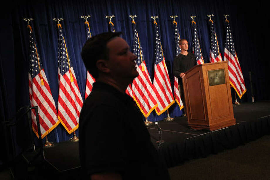 At the Francis Marion Hotel in Charleston, S.C., the location of the Red State Gathering 2011, workers on Friday adjust the lighting for the podium where Gov. Rick Perry is expected to announce today that he's running for president. Photo: Lisa Krantz, San Antonio Express-News