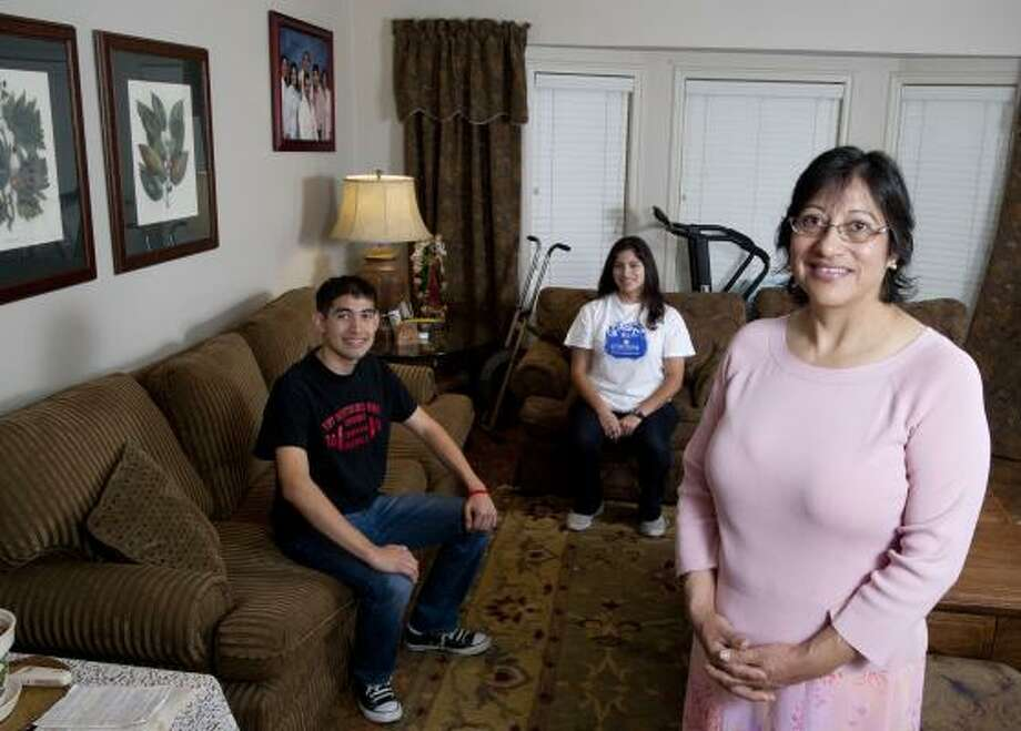 Rebeca Figuroa, a housekeeper, plans to save $20 a week for her son, John, who will graduate in 2012. KIPP will match her contributions. Her daughter, Becky, graduated from KIPP in June, too soon for the program, but she will be attending Concordia University. Photo: Thomas B. Shea, Chronicle