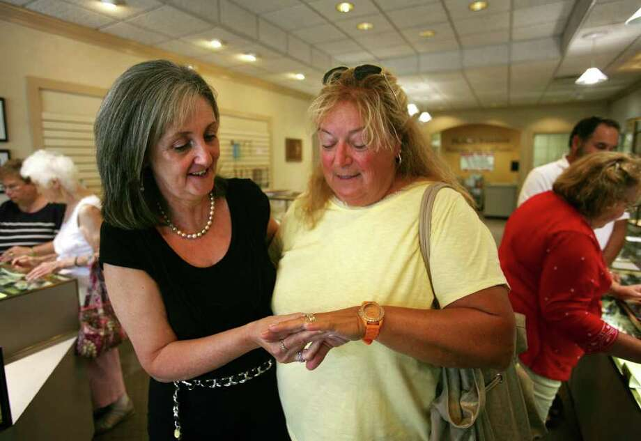 Louise Hebert, left, looks at a ring that her business, Hebert Jewelers, made for long time customer Beverly DuBour, right of Milford. The store, at 14 Broad Street in Milford, is going out of business after 58 years. Photo: Brian A. Pounds / Connecticut Post