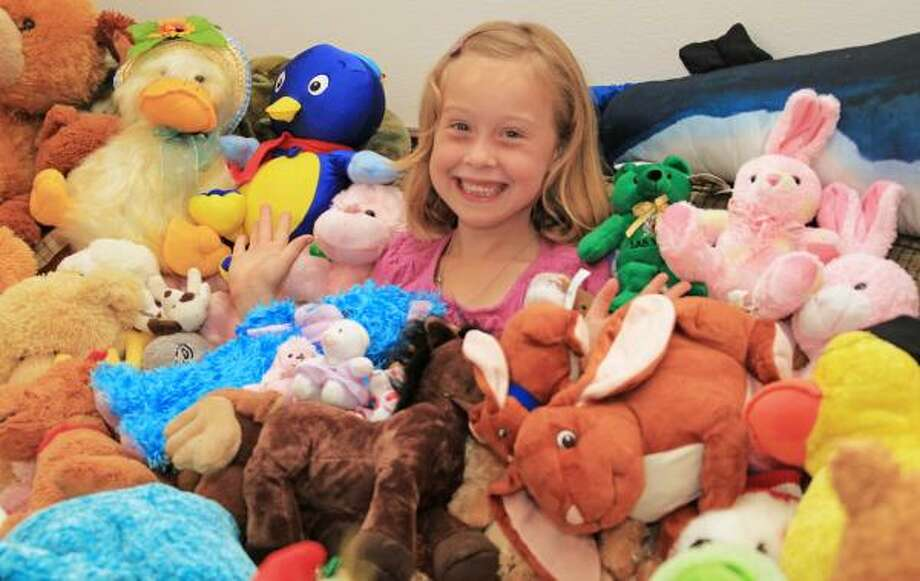 Morgan Sellers, 7, sits with a few of the stuffed animals she has collected for children affected by a devastating tornado in Joplin, Mo. Photo: Christy Wooten, For The Chronicle