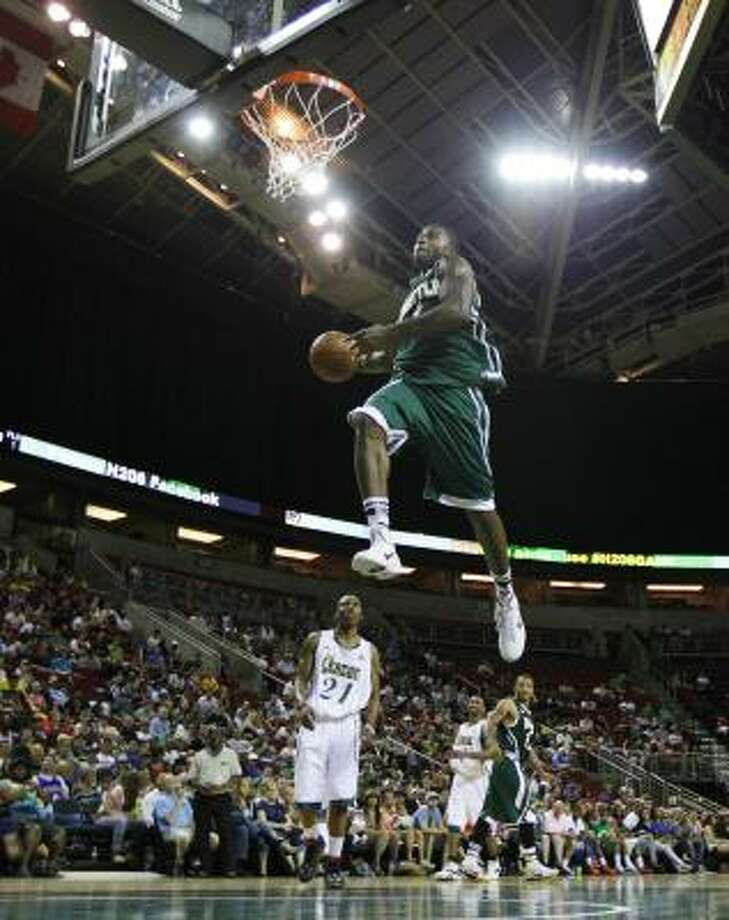 Rockets forward Terrence Williams looks to dunk the ball in the second half of a charity basketball game on Saturday. Photo: Ted S. Warren, Associated Press