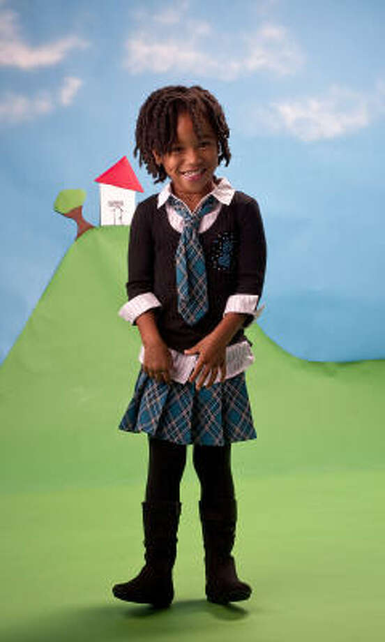 Sesily wears a two-piece plaid skirt and shirt set, $42 at Kohl's. Her Arizona boots are $40 at J.C. Penney. Photo: Karen Warren, Houston Chronicle