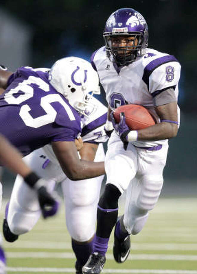 Angleton's Ryan Jackson rushed for 1,315 yards and 12 touchdowns last season. Photo: Julio Cortez, Chronicle