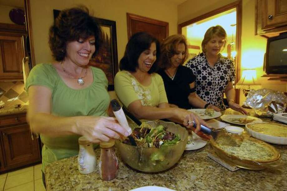 CLUB LEADERS: Debbie Reinhardt, left, hosts board members of the Copperfield Women's Club at her home. The board includes Gracie Garza, second from left, Rosie Serrano-Garcia and Janet Barber. Photo: Tony Bullard, For The Chronicle