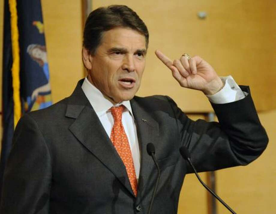 Tea party voters like Rick Perry, but some of his views — on New York's gay-marriage law, for instance — give them pause. Photo: Bill Kostroun, Associated Press