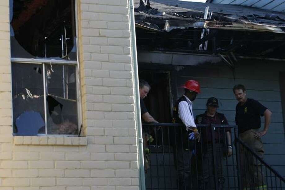 Fire crews work at the blaze site on Corporate in Houston. Photo: Johnny Hanson, For The Chronicle