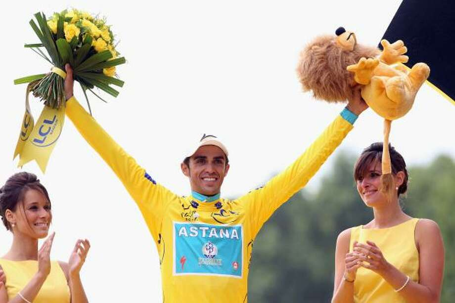 Alberto Contador of team Astana celebrates victory on the podium after the twentieth and final stage of Le Tour de France 2010. Photo: Bryn Lennon, Getty