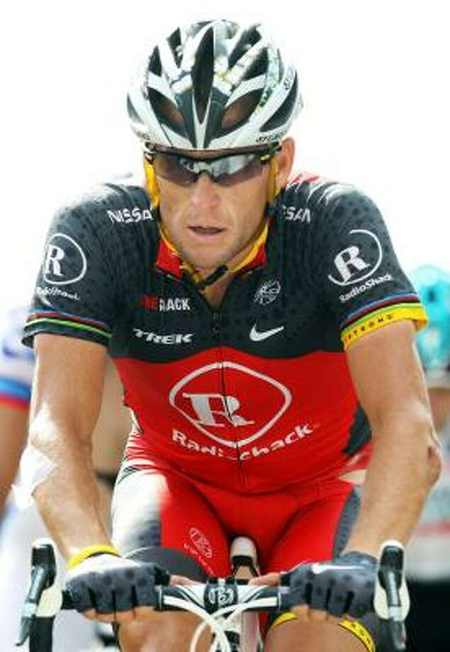 As for Lance Armstrong, he's out of mind and out of sight — until the last two days, when he arrives in Grenoble for the time trial to schmooze his Team RadioShack sponsors. Photo: Bryn Lennon, Getty Images