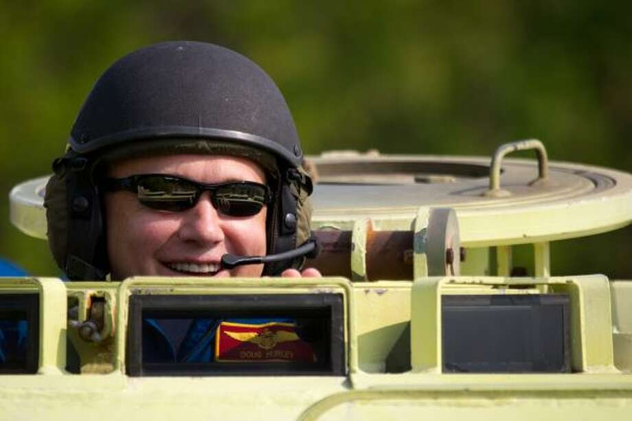 Pilot Doug Hurley drives a personnel carrier during safety training at Kennedy Space Center last month. Photo: Smiley N. Pool, Chronicle