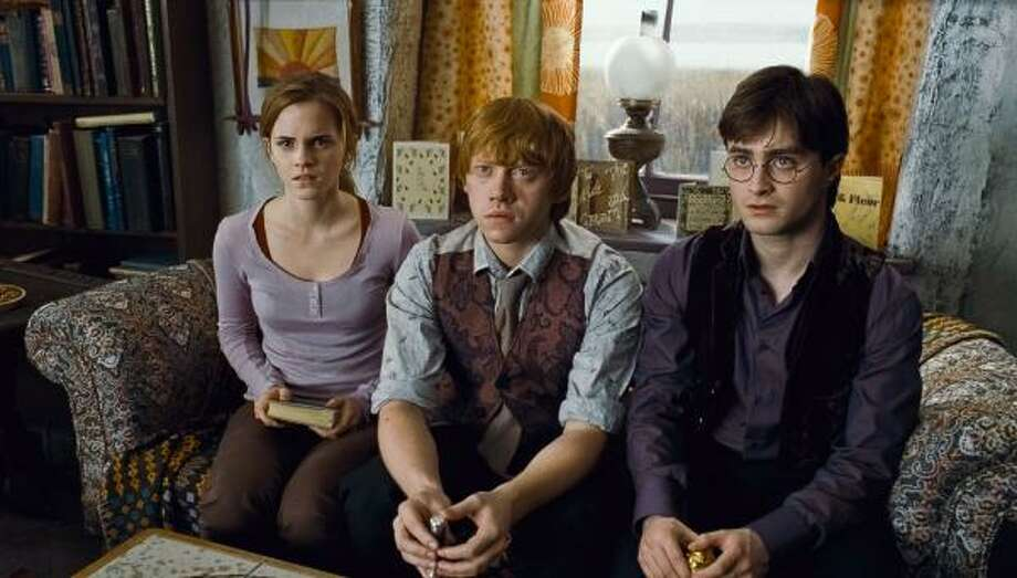 Audiences have had the opportunity to watch Hermione Granger (Emma Watson), from left, Ron Weasley (Rupert Grint) and Harry Potter (Radcliffe) grow up onscreen. Photo: Warner Bros. Pictures