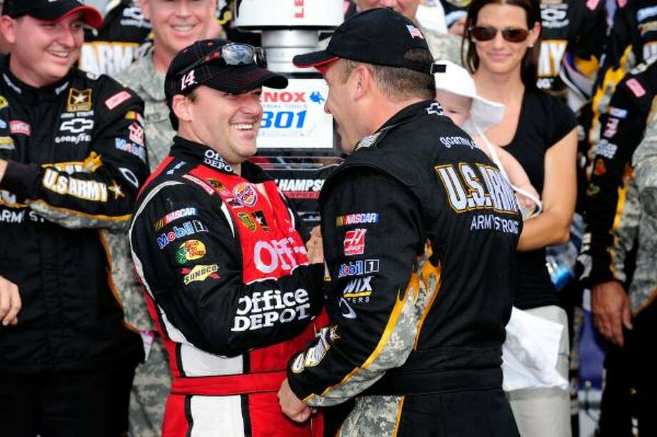 Ryan Newman, right, is congratulated by team owner and runner-up Tony Stewart after the duo finished first and second in Sunday's Sprint Cup race at Loudon, N.H. Photo: Jared C. Tilton, Getty