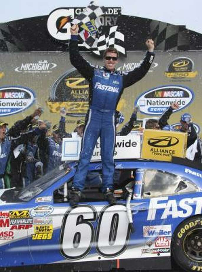 Carl Edwards wins the NASCAR Nationwide Series Alliance Truck Parts 250 at Michigan international Speedway in Brooklyn, Michigan on Saturday. Photo: Bob Brodbeck, Associated Press