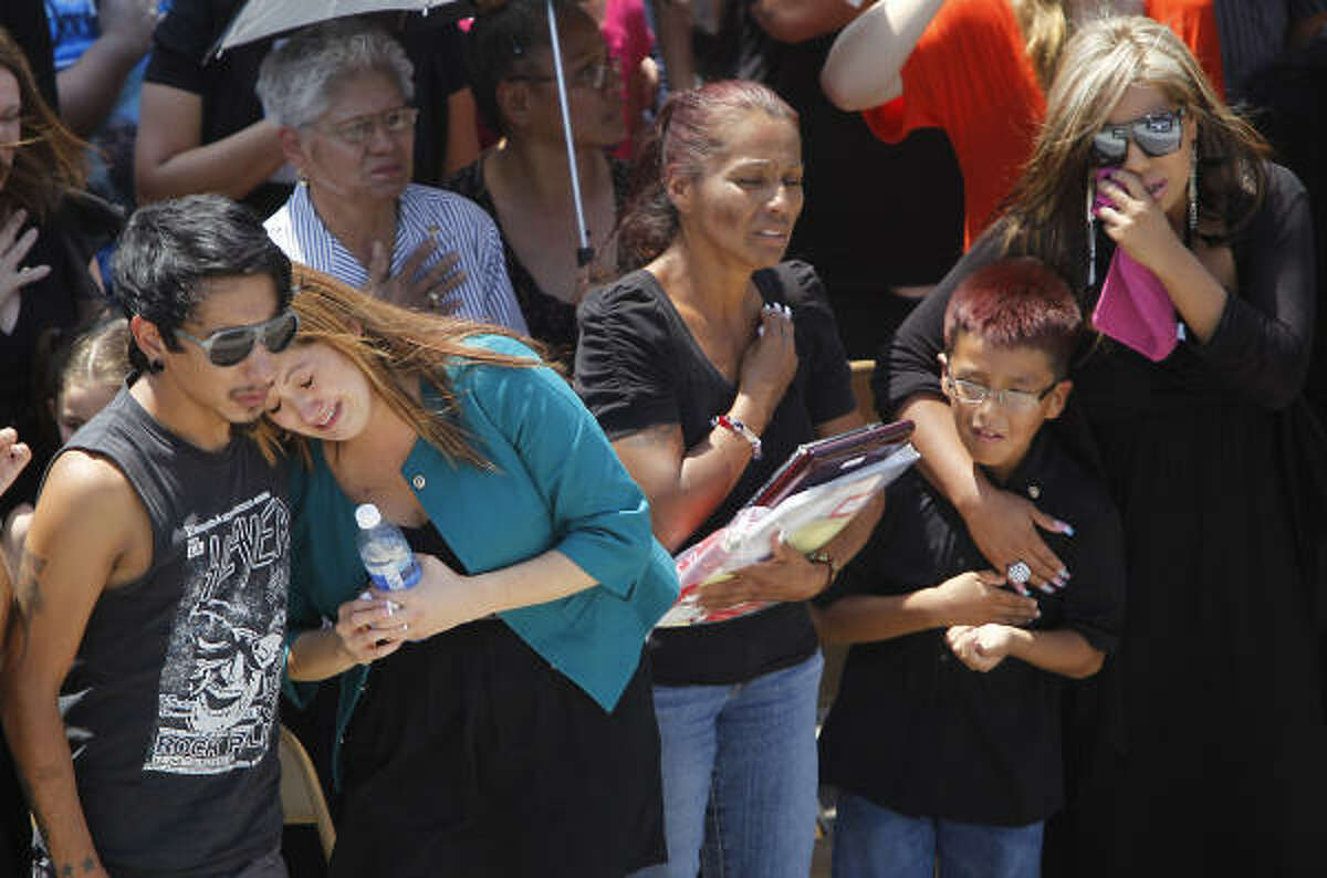 Family members of Army Sgt. Jacob Molina - left to right, brother Richard Molina Jr., wife Stephanie Molina, mother Janie Torres, brother Shawn Carreon and sister Roxanne Ramirez - cry as the honor guard fires the rifle salute at Veterans Memorial Cemetery on Monday. Molina was killed July 19 in Afghanistan when his vehicle was struck by an improvised explosive device.