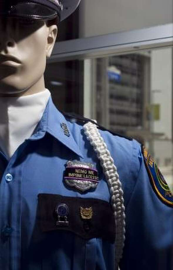 Like those of the past, the current uniform can be seen at the police headquarters museum in Houston. See other police uniforms through the years. Photo: Nick De La Torre, Chronicle
