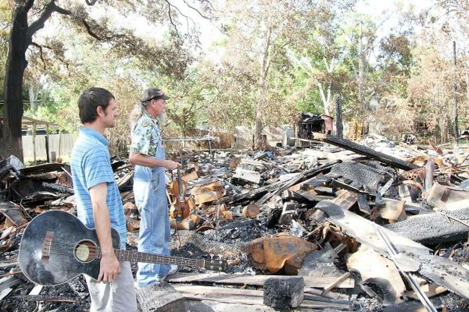 CHARRED REMAINS: A July 6 fire destroyed the Shoreacres home of Jimmy Permenter and his son, Joseph, but it wasn't the first time they lost everything. In 2008, Hurricane Ike wiped the house off the landscape, and he rebuilt. Firefighters tried to save the house this time, but Ike also crippled their ability to do their jobs. Photo: Pin Lim, For The Chronicle