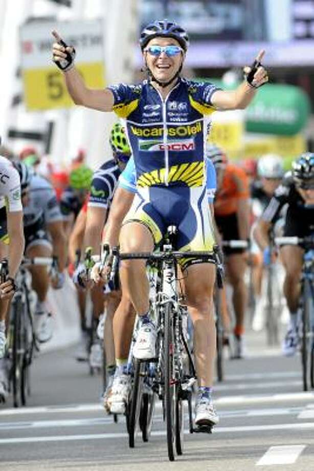 Slovak Borut Bozic from team Vacancesoleil raises his arms after crossing the finish line to win the fifth stage, a 204,4 km race from Huttwil to Tobel-Taegerschen, at the 75th Tour de Suisse UCI ProTour cycling race. Photo: Jean-Christophe Bott, Associated Press