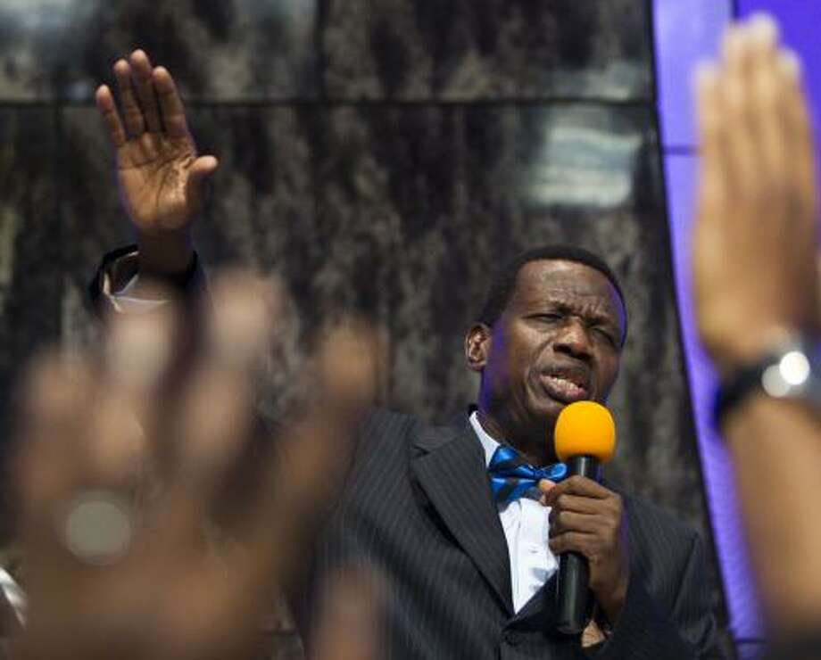 Pastor Enoch Adeboye preaches to the congregation at the Redeemed Christian Church of God. Photo: Brett Coomer Photos, Chronicle