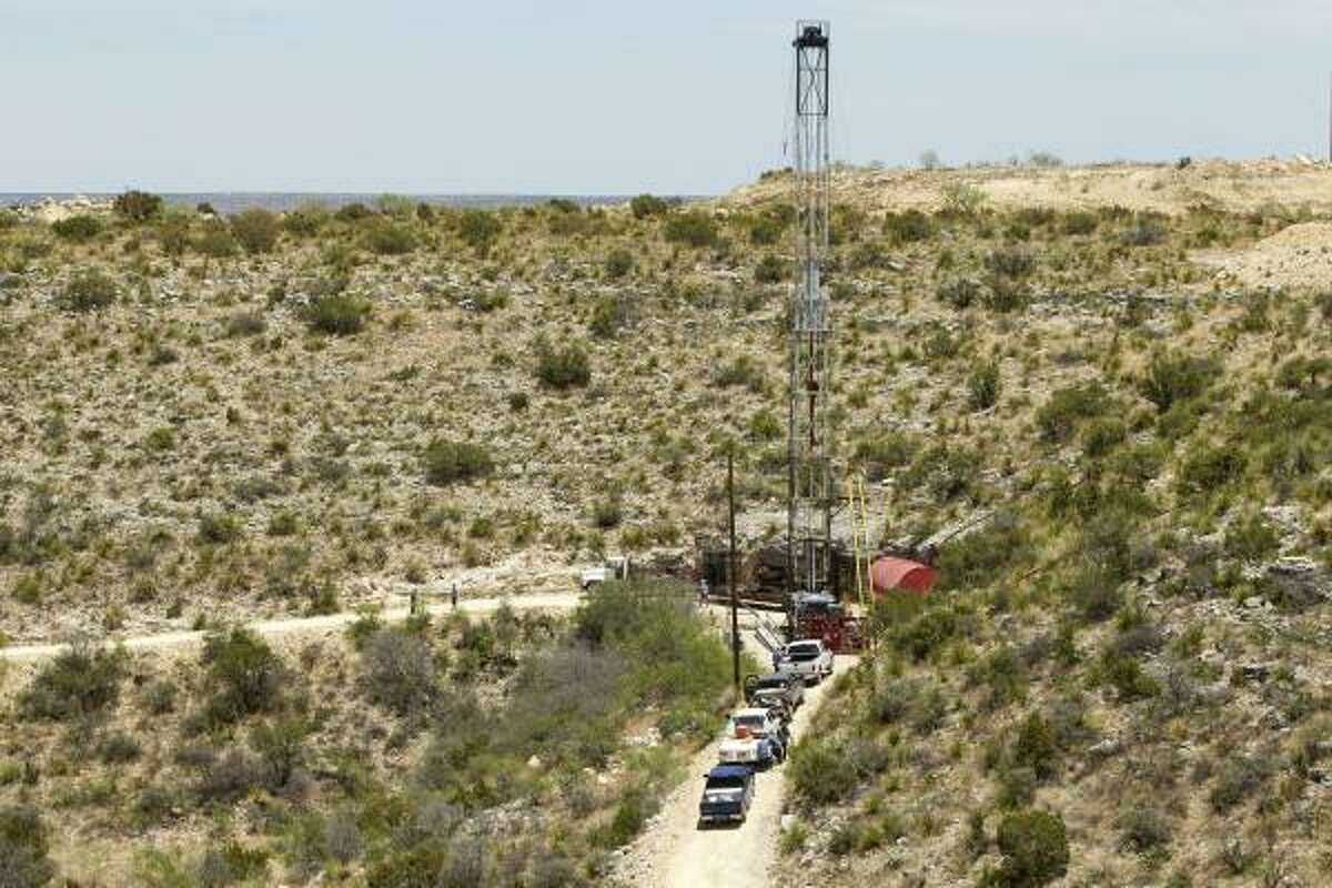 Drilling rigs are part of the landscape in the Yates Field, south of Midland. Kinder Morgan, owner of the field since 2003, is trying to stabilize production there.