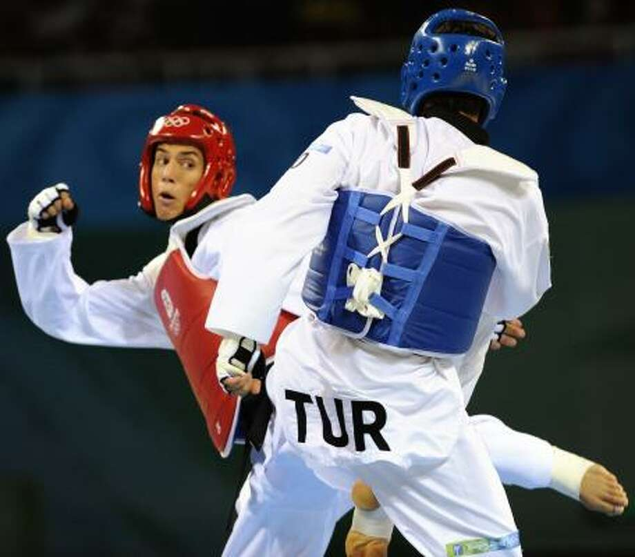 Two-time gold medalist Steven Lopez, left, and his sister Diana Lopez, a 2008 bronze medalist, will fight this week in Azerbaijan at the World Taekwondo Federation's world Olympic qualifier. Photo: Jay Hu, For The Chronicle