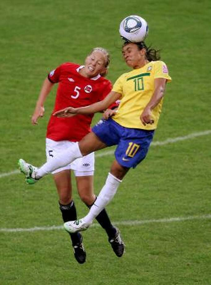 Brazil's Marta, right, beats Norway's Marita Skammelsrud Lund to the ball during Brazil's 3-0 win Sunday in Augsburg, Germany. Marta had a hand in all three goals. Photo: Scott Heavey, Getty