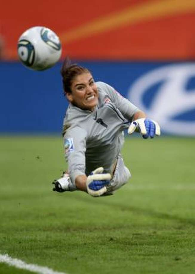 Hope Solo's eventful match against Brazil ends on an up note as she makes a save during the penalty kick shootout that allowed the U.S. to move on to the semifinals. Photo: Scott Heavey, Getty