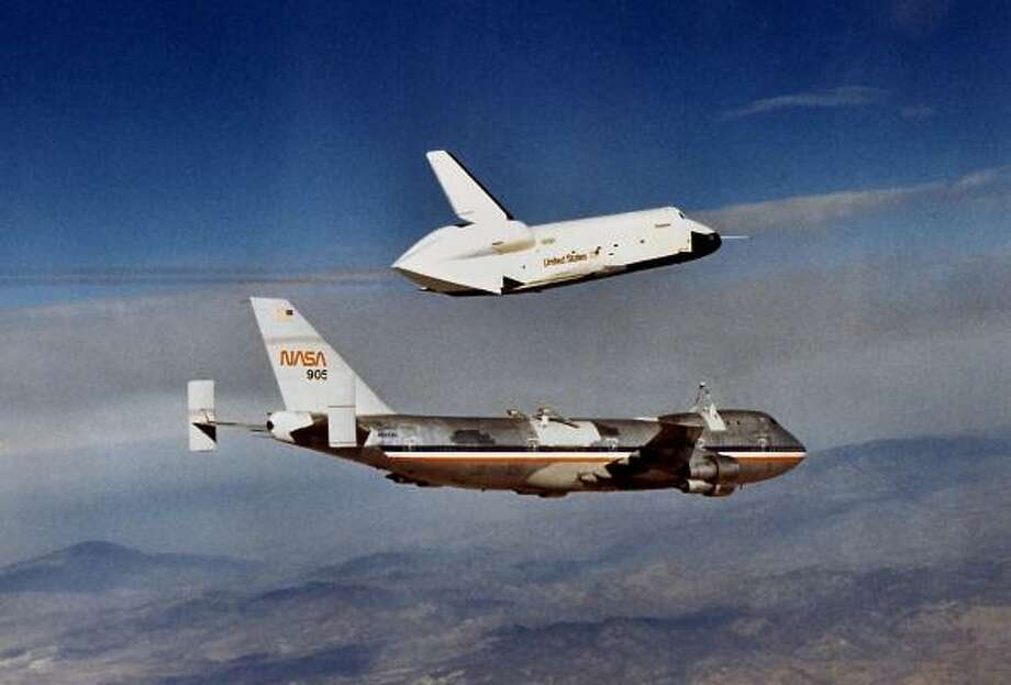 Enterprise is released from a 747 during a 1977 test flight. Photo: NASA PHOTO, Getty