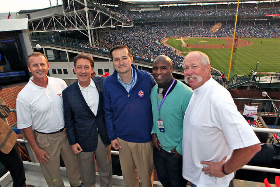 From left, Rick Barnes, basketball coach, University of Texas; George Bodenheimer, President of ESPN; Tom Ricketts, Chicago Cubs owner; Ricky Williams, Heisman Trophy winner and NFL running back and Goose Gossage, MLB Hall of Fame pitcher overlooking Wrigley field for the Cubs vs. Brewers on June 14, 2011. Barnes and Williams were in town to talk about Longhorn Network at ESPN's NCTA booth. Photo: Will Byington, For ESPN
