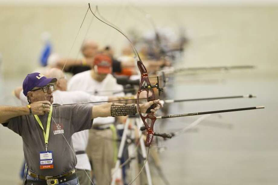 Albert Gautreaux, of Louisiana, practices for the 2011 Summer National Senior Games on Thursday at Reliant Center. Gautreaux will be competing in the 65- to 69-year-old division in archery. There are more than 10,000 participants in the games. Photo: Michael Paulsen, Chronicle