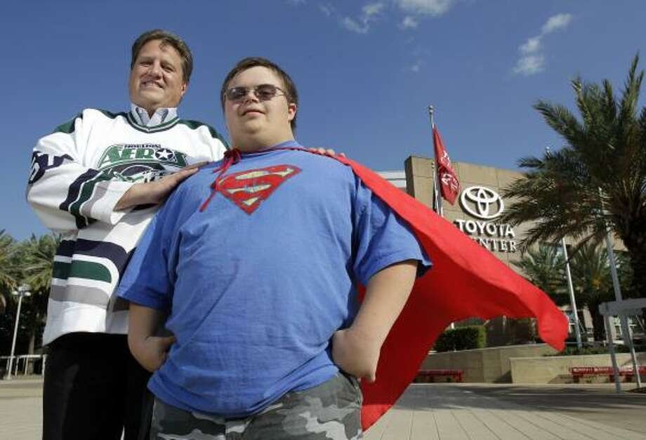 Aeros fans Rick Chern, left, and his son, Jacob, teamed up during the team's playoff run to provide a superhero sideshow to power-play opportunities by the good guys. Photo: Melissa Phillip, Chronicle