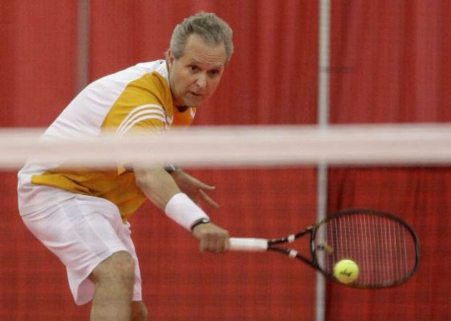 Charlie Siracusa, 58, has won the Michigan Senior Games tennis championship three years in a row starting in 2009. Photo: Thomas B. Shea, For The Chronicle
